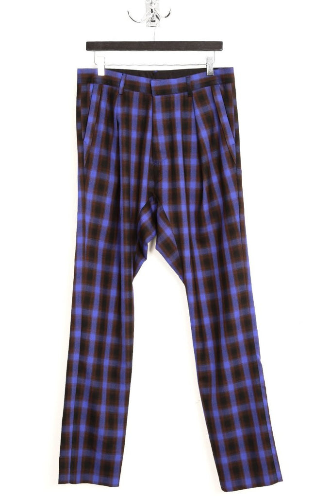 UNCONDITIONAL blue and black check pleated drop crotch trousers.