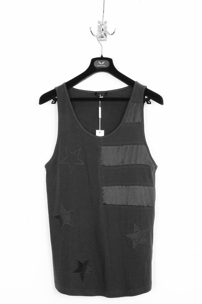 UNCONDITIONAL Black cotton and silk stars and stripes high neck vest.