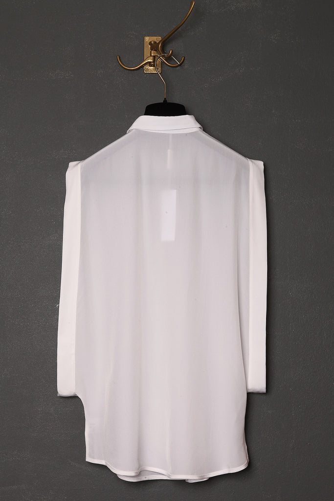 UNCONDITIONAL optical white  open side blouse with pie crust collar.