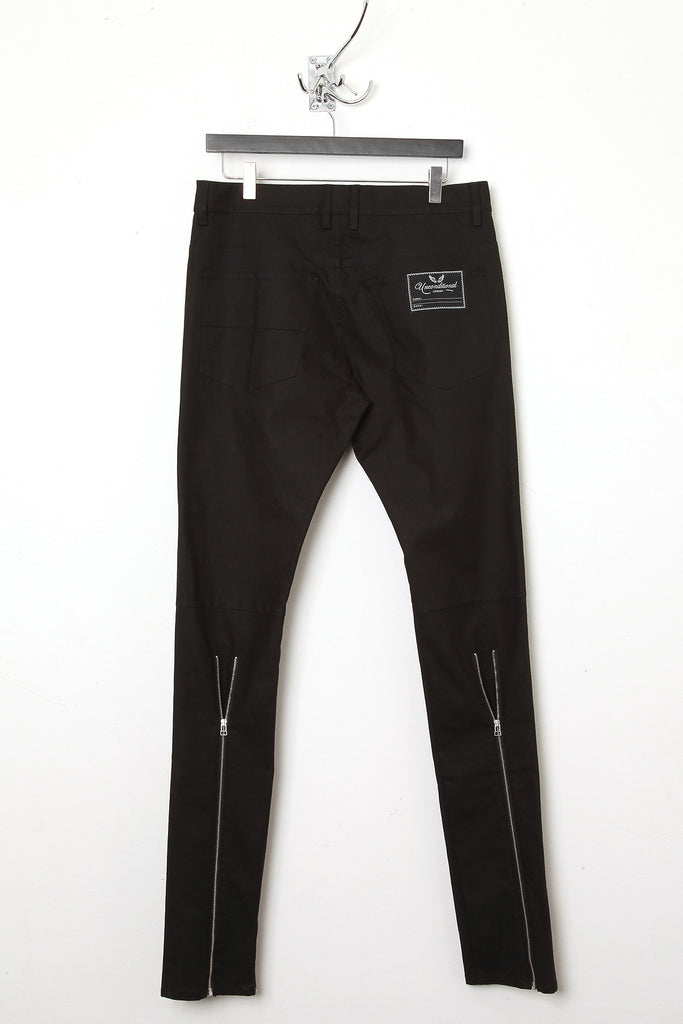 UNCONDITIONAL Black skinny jeans with signature back zip detail.