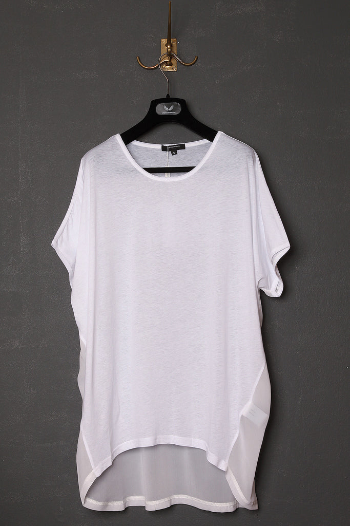 UNCONDITIONAL All white tail tee with silk chiffon lower back.