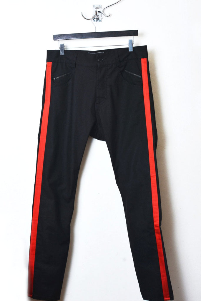 UNCONDITIONAL AW18 BLACK|RED tuxedo stripe jeans with taped back zip detailing