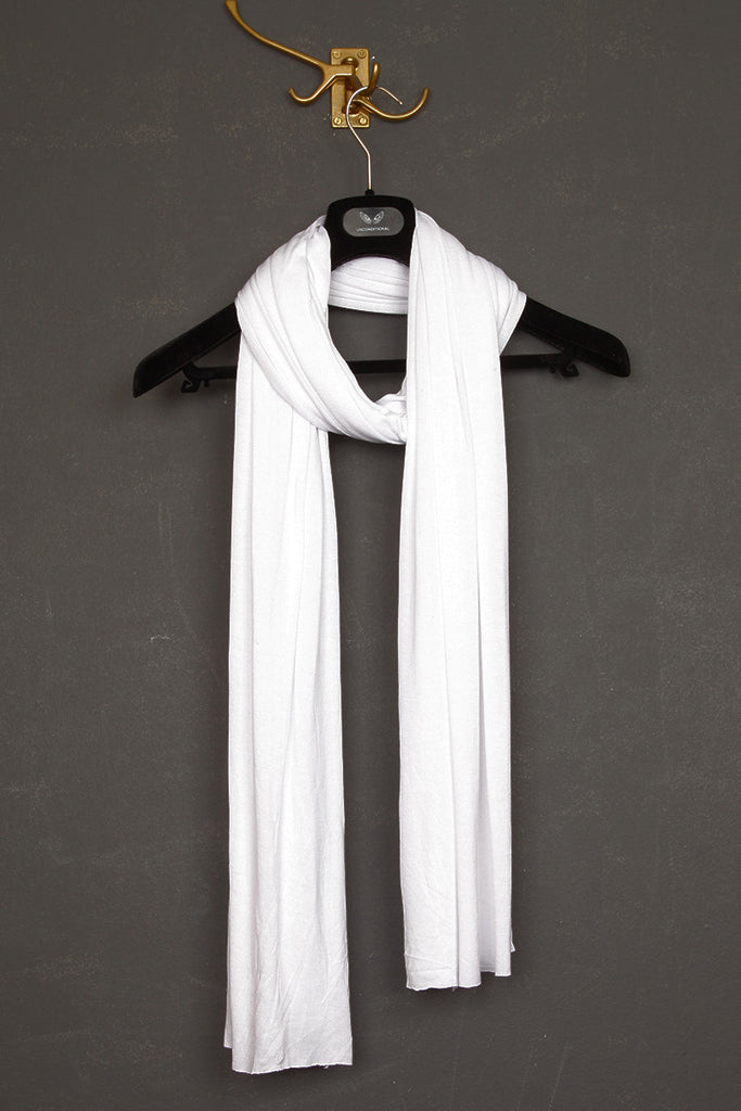 UNCONDITIONAL cashmere feel white rayon loose knit scarf.