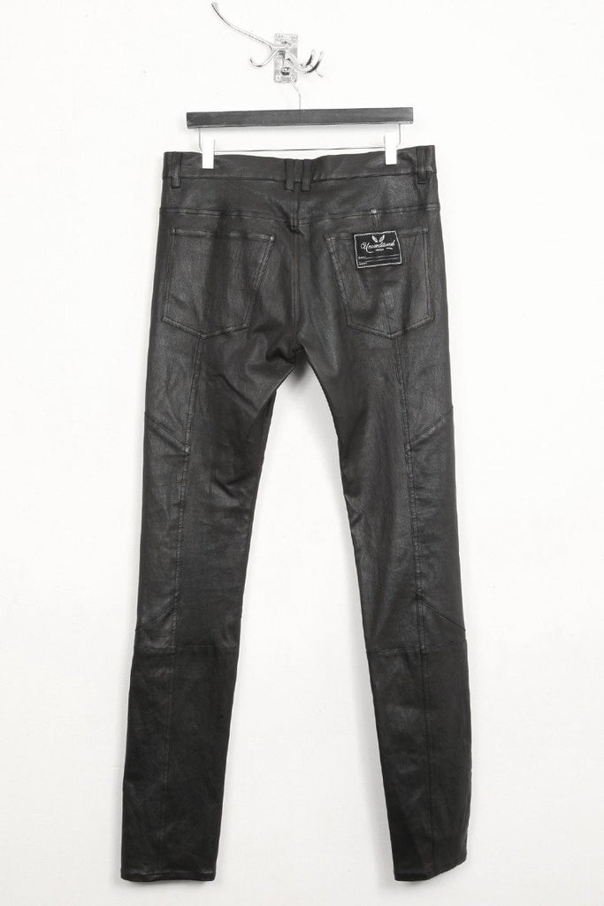 UNCONDITIONAL black stretch leather patchwork skinny trousers.