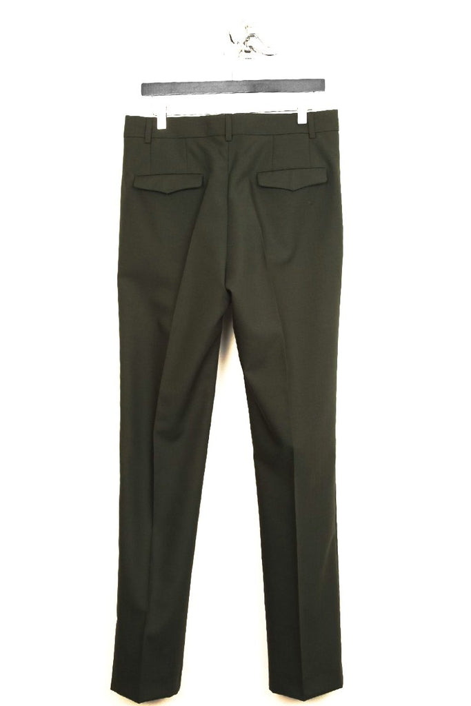 UNCONDITIONAL dark green cigarette tailored trousers.