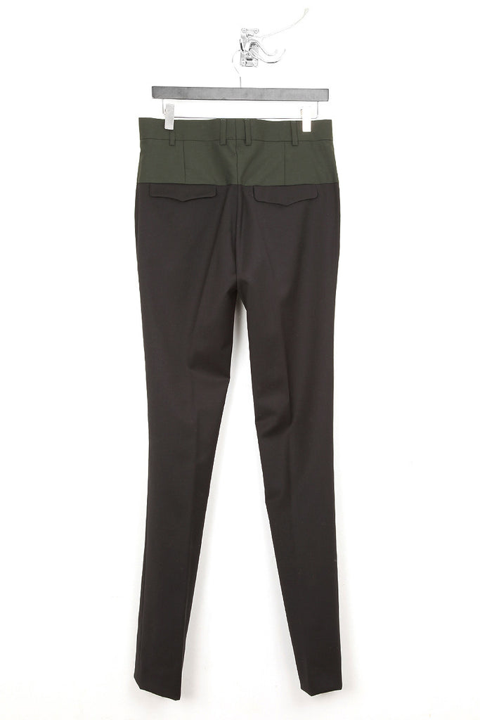 UNCONDITIONAL dark green top and black bottom panelled cigarette trousers.