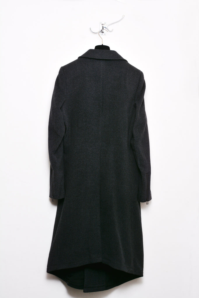 UNCONDITIONAL BLACK LONG COAT WITH ASYMMETRIC HEM AND ZIP OFF COLLAR.