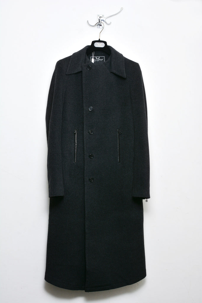 UNCONDITIONAL BLACK WOOL LONG COAT WITH ASYMMETRIC HEM AND ZIP OFF COLLAR.