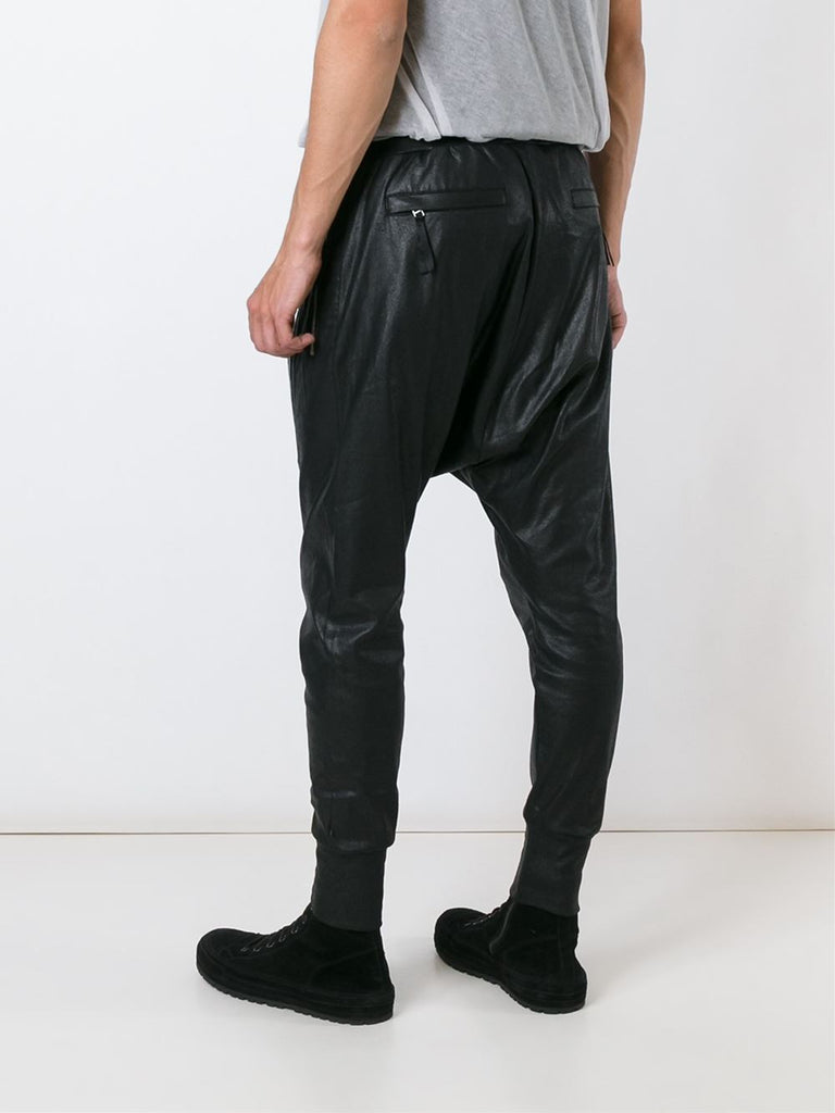 UNCONDITIONAL Leather look foiled black drop crotch trousers with front zip detailing