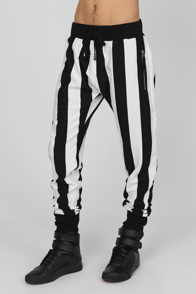 UNCONDITIONAL Black and Off White striped slim jersey trousers , with zip up pockets.