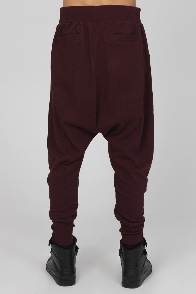 UNCONDITIONAL Grape drop crotch trousers with double silver zip pockets.