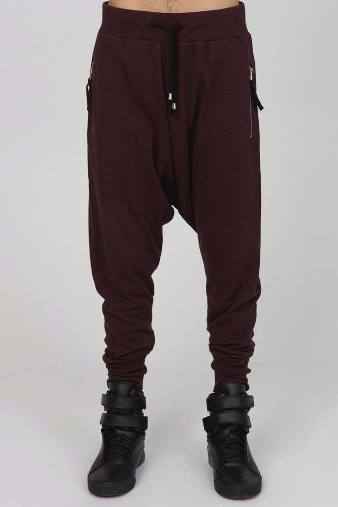 UNCONDITIONAL's new grape drop crotch trousers with double silver zip pockets.