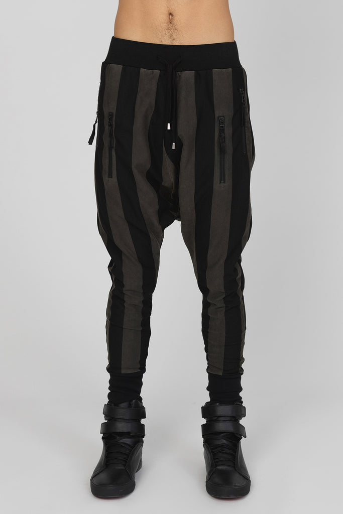 UNCONDITIONAL Black and military cold dye drop crotch trousers , black back zips & double zip pockets.