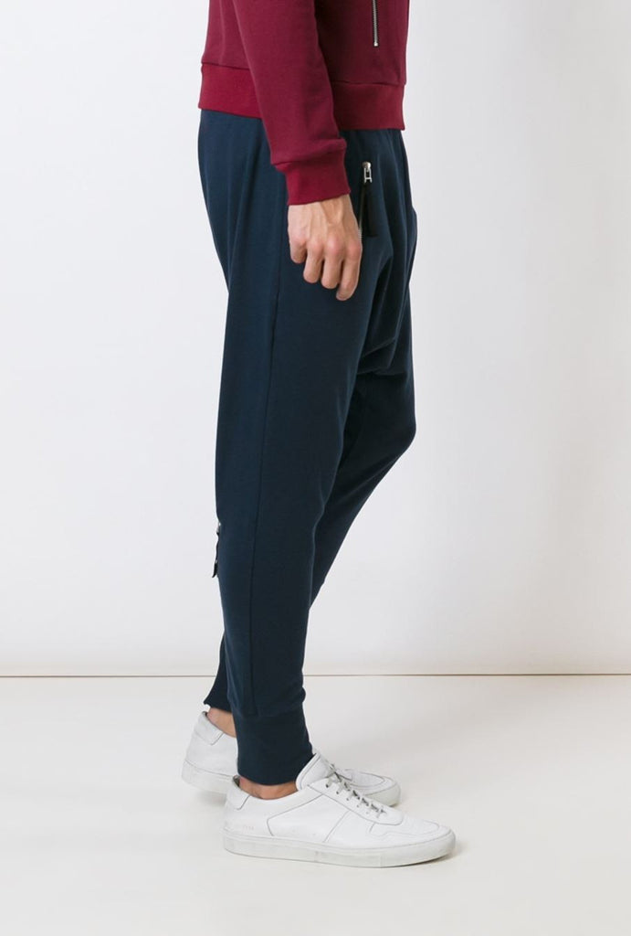 UNCONDITIONAL Navy full length higher crotch heavy jersey trousers with back zips.