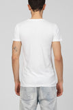 UNCONDITIONAL White V-neck T-shirt with gold shard neck beading