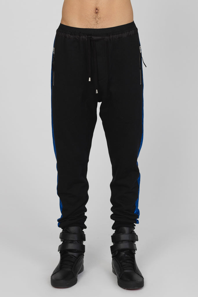 UNCONDITIONAL Black sweat trousers with blue metallic contrast tuxedo stripe
