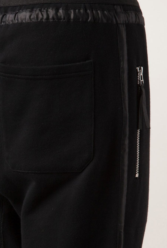 UNCONDITIONAL signature Black slim sweat trousers with a microfibre tux stripe.