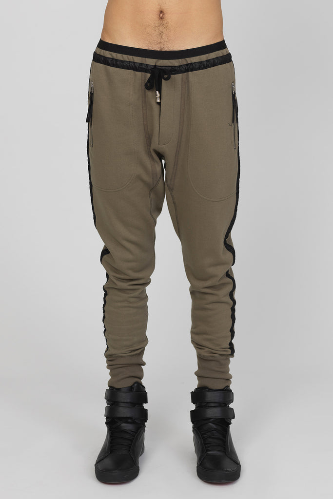 UNCONDITIONA Army slim fit sweat trousers with black microfibre tuxedo stripe.