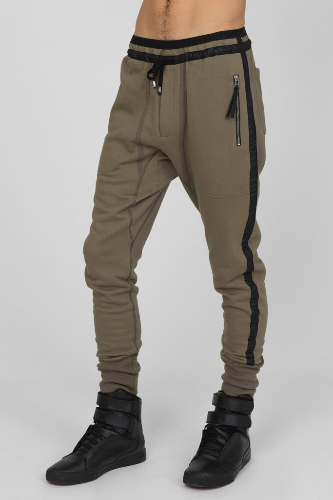 UNCONDITIONA AW19 Army slim fit sweat trousers with black microfibre tuxedo stripe.