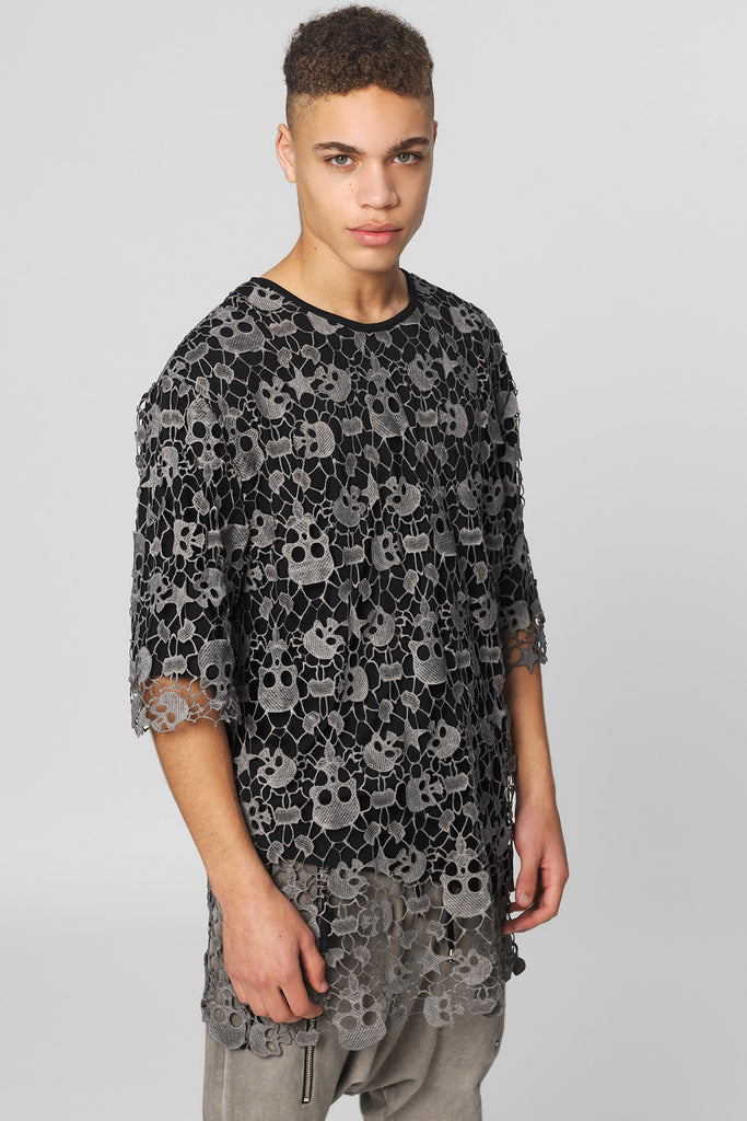 UNCONDITIONAL signature oversized black T shirt with a military cold dye cotton skull lace overlay.