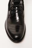 UNCONDITIONAL Black Rocco Boot with soundwave broguing detail.