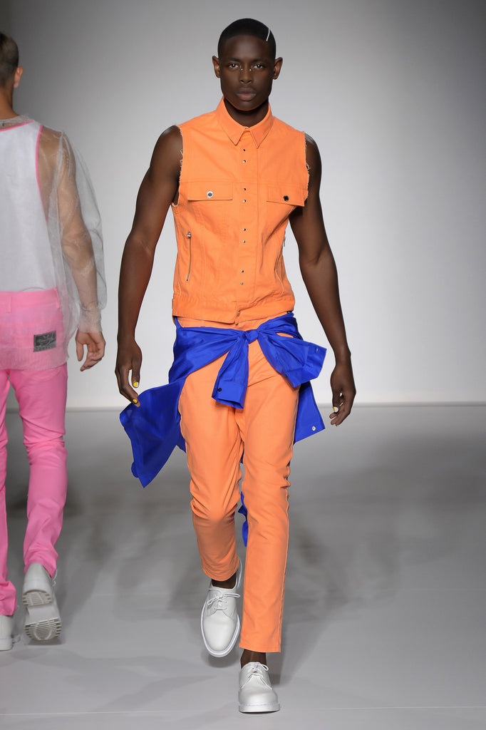 UNCONDITIONAL neon orange light denim jeans with a signature slight drop crotch