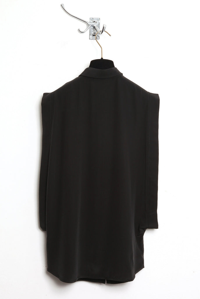 UNCONDITIONAL SS16 black open side blouse with pie crust collar.
