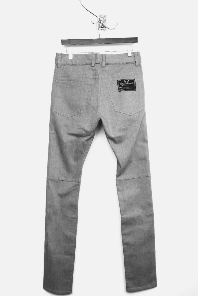 UNCONDITIONAL light grey stretch denim skinny jeans with zips inserted.