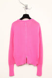 UNCONDITIONAL fluoro pink crew neck mesh knitted jumper with zip up back.