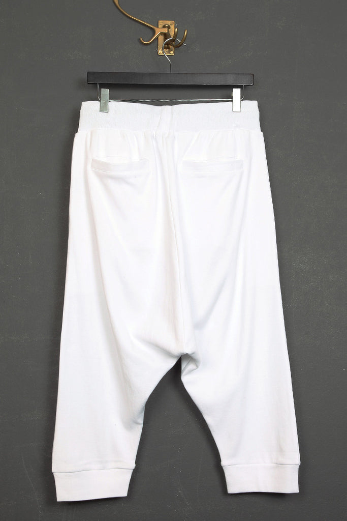 UNCONDITIONAL White drop crotch shorts with rib waistband.