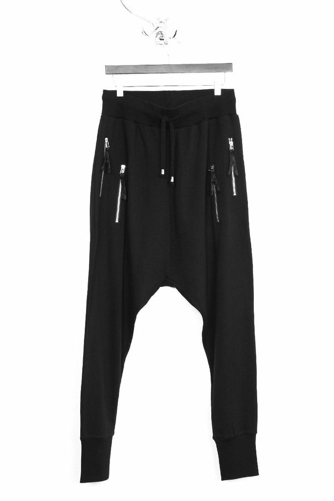 UNCONDITIONAL Black drop crotch full length trousers with double zip pockets.