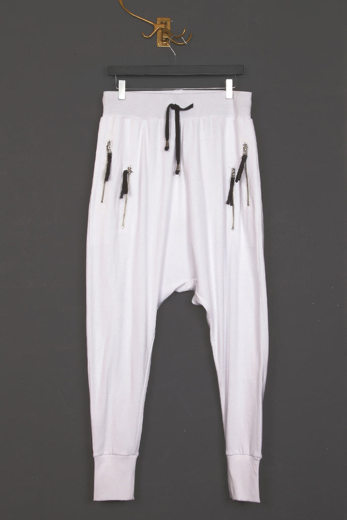 UNCONDITIONAL SS19 White drop crotch full length trousers with white zip pockets.