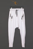 UNCONDITIONAL's White drop crotch full length trousers with double zip pockets.