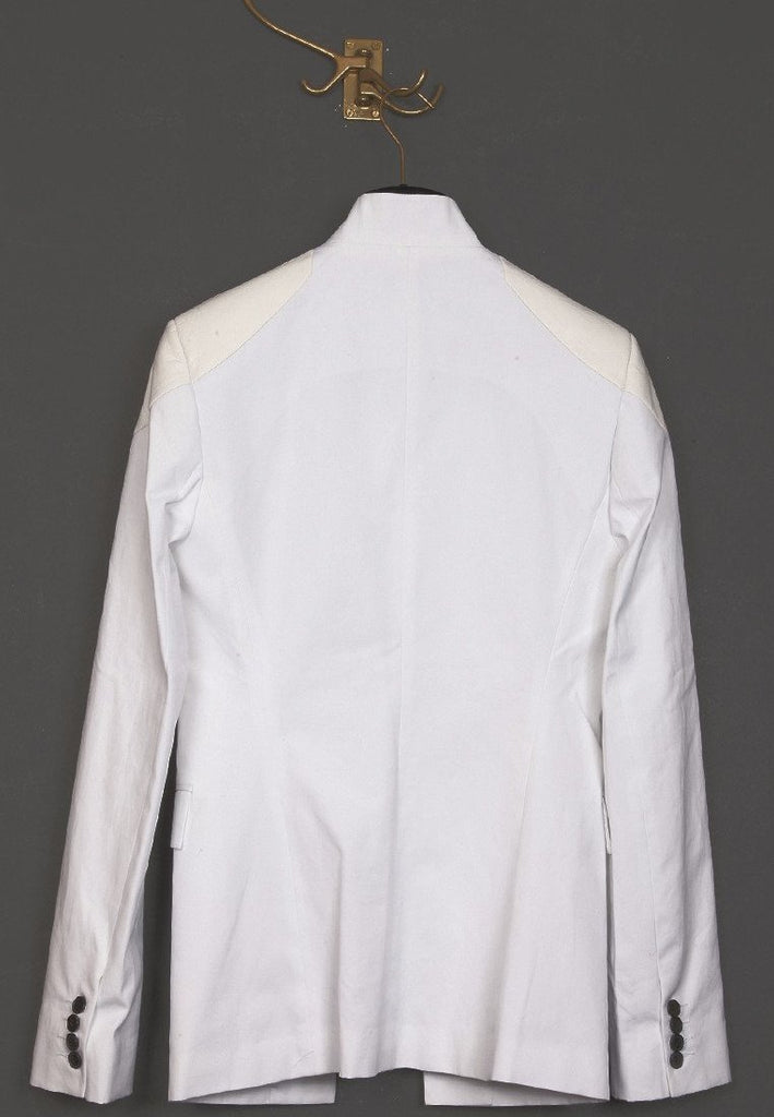 UNCONDITIONAL white canvas and white leather cutaway jacket with notch.