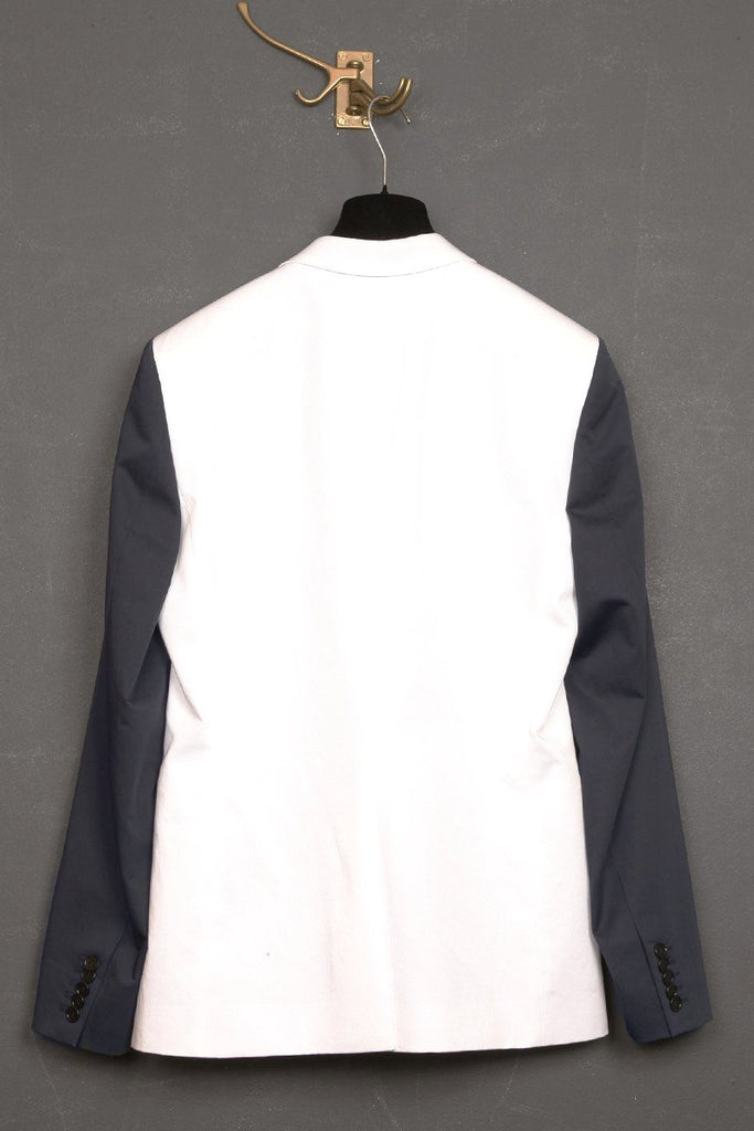 UNCONDITIONAL white and navy crinkle tailored 1 button jacket with contrast sleeves and lapel.