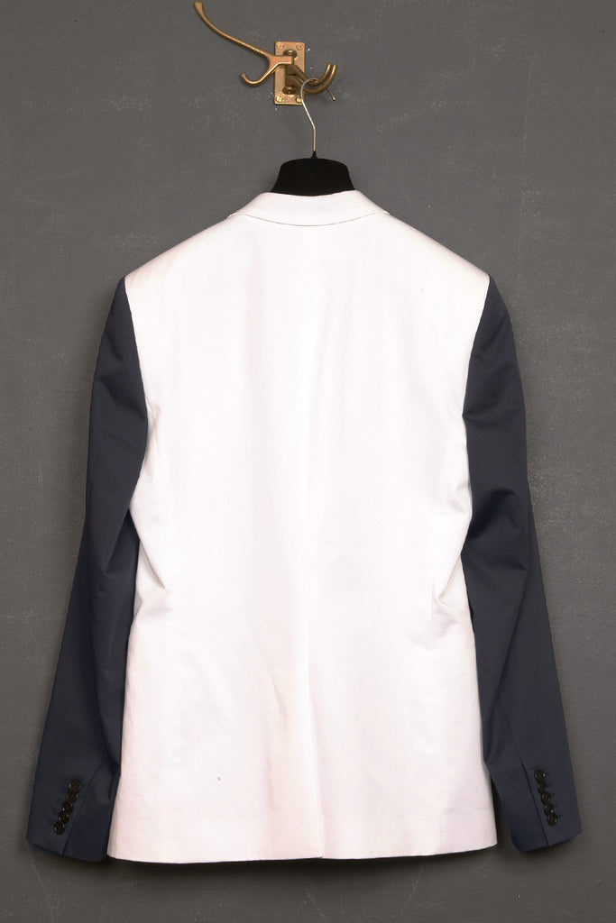 UNCONDITIONAL White and navy 1 button jacket with contrast sleeves and lapel.