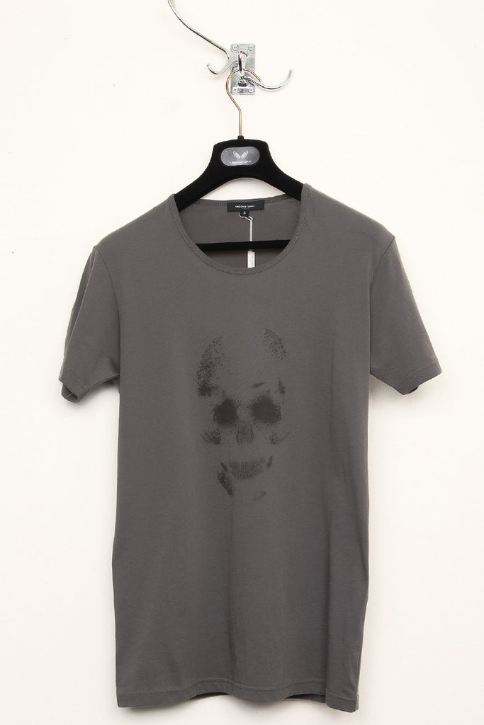 UNCONDITIONAL military with black skull print round neck tee.
