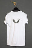 UNCONDITIONAL white with black skull print round neck tee with wings on back.