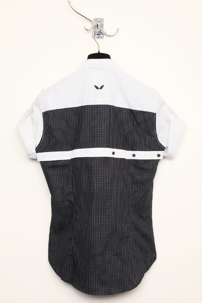 UNCONDITIONAL white grid check with contrast black grid check harness short sleeved shirt.