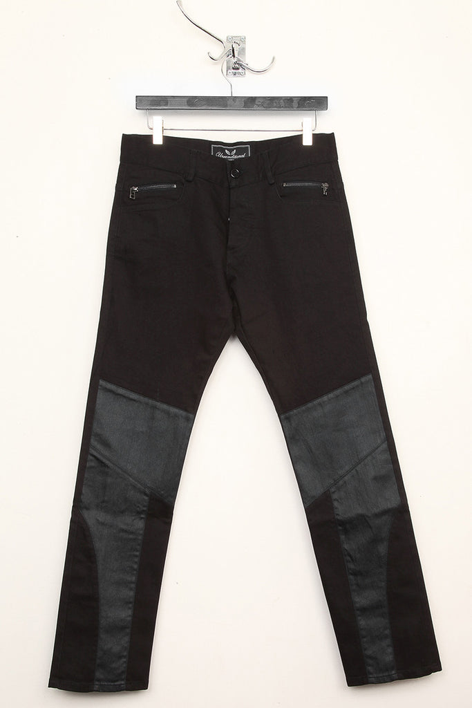 UNCONDITIONAL Black denim slim fit panelled plain and coated denim jeans with back zips.