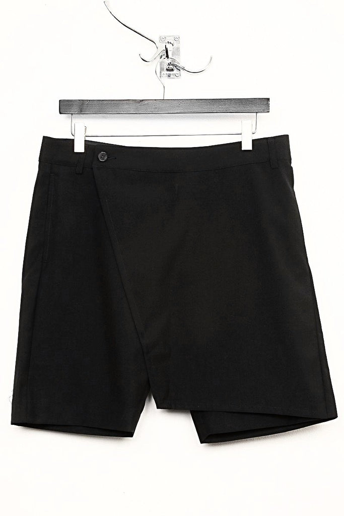 UNCONDITIONAL AW18 Black wool tailoring wrap flap 'skirt' shorts.