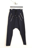 UNCONDITIONAL Navy drop crotch jersey trousers with double zip pockets.