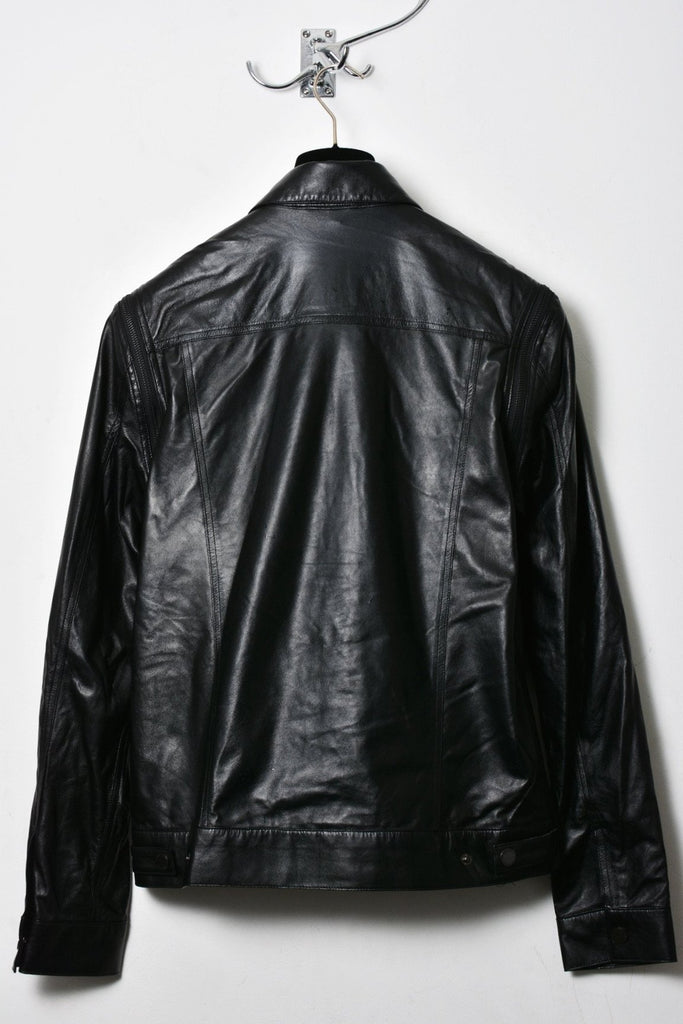 UNCONDITIONAL Black fine lambs leather denim style jacket with zip off sleeves.