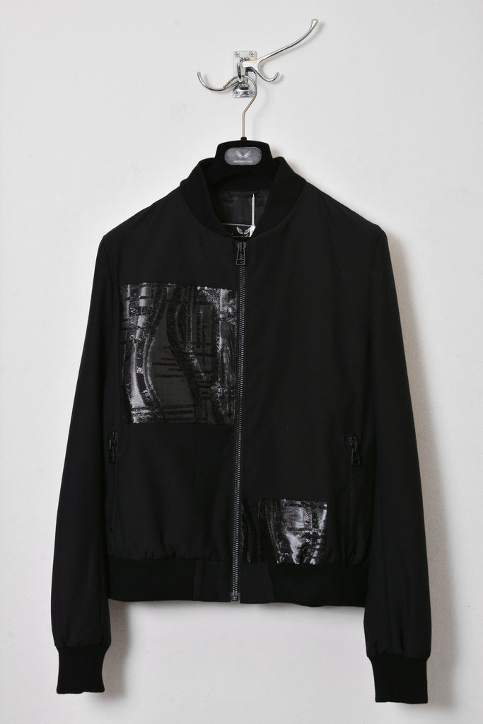 UNCONDITIONAL Black bomber jacket with microchip patches.