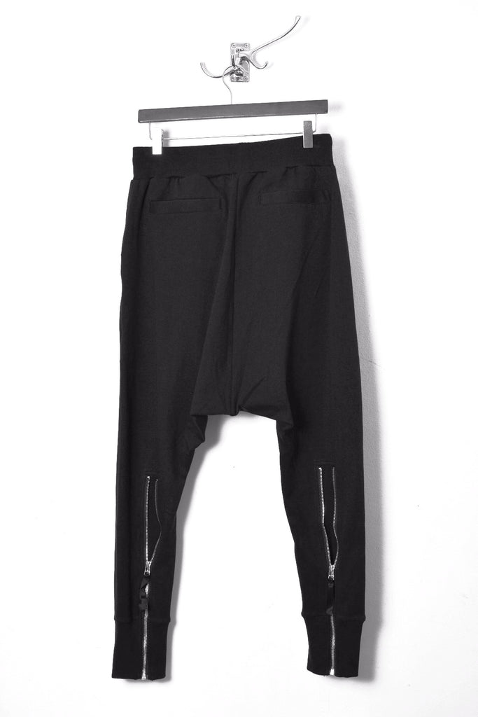 UNCONDITIONAL SS20 Black double zip pocket drop crotch trousers with back zips