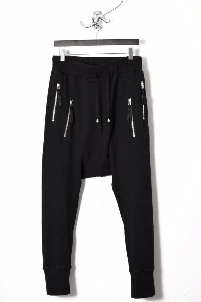UNCONDITIONAL  Black double zip pocket drop crotch trousers with back zips