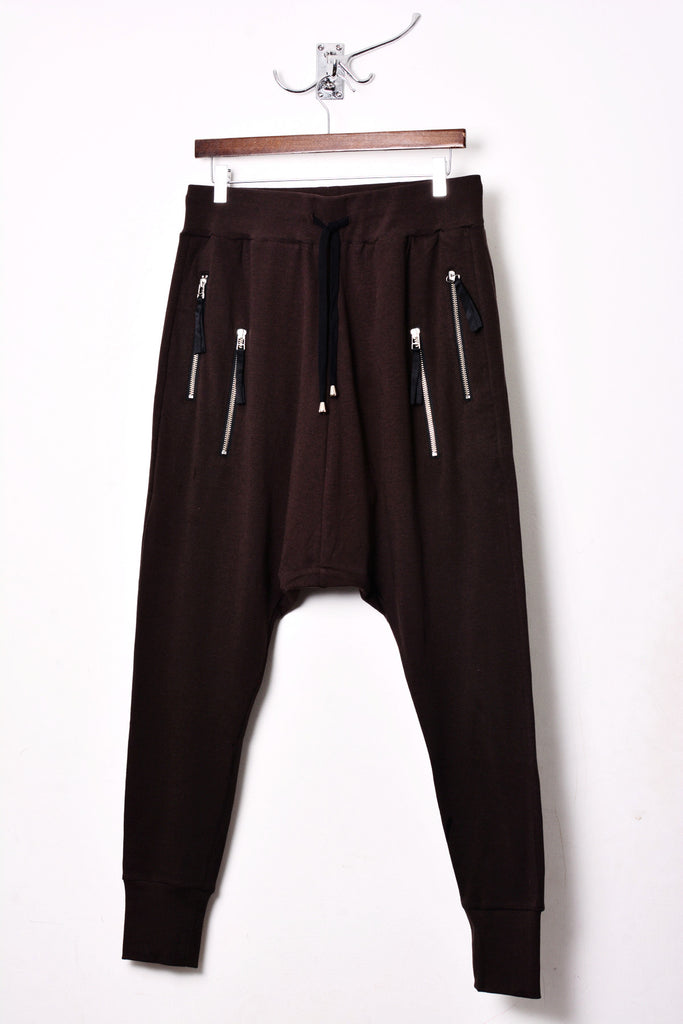 UNCONDITIONAL bitter chocolate drop crotch full length trousers with double zip pockets.