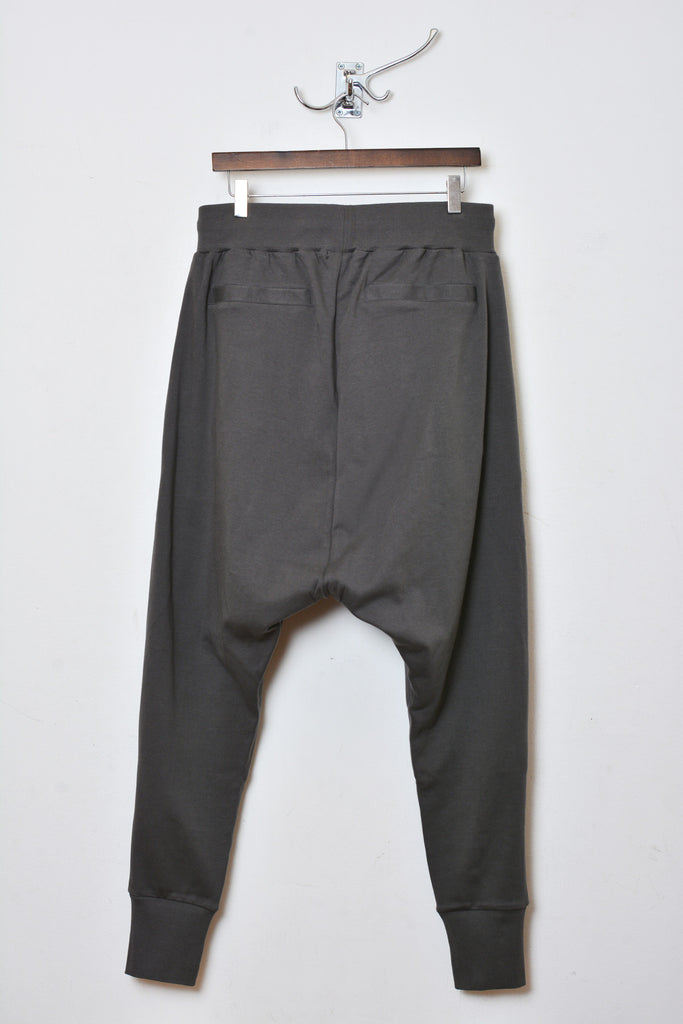 UNCONDITIONAL Zinc drop crotch full length trousers with double zip pockets.