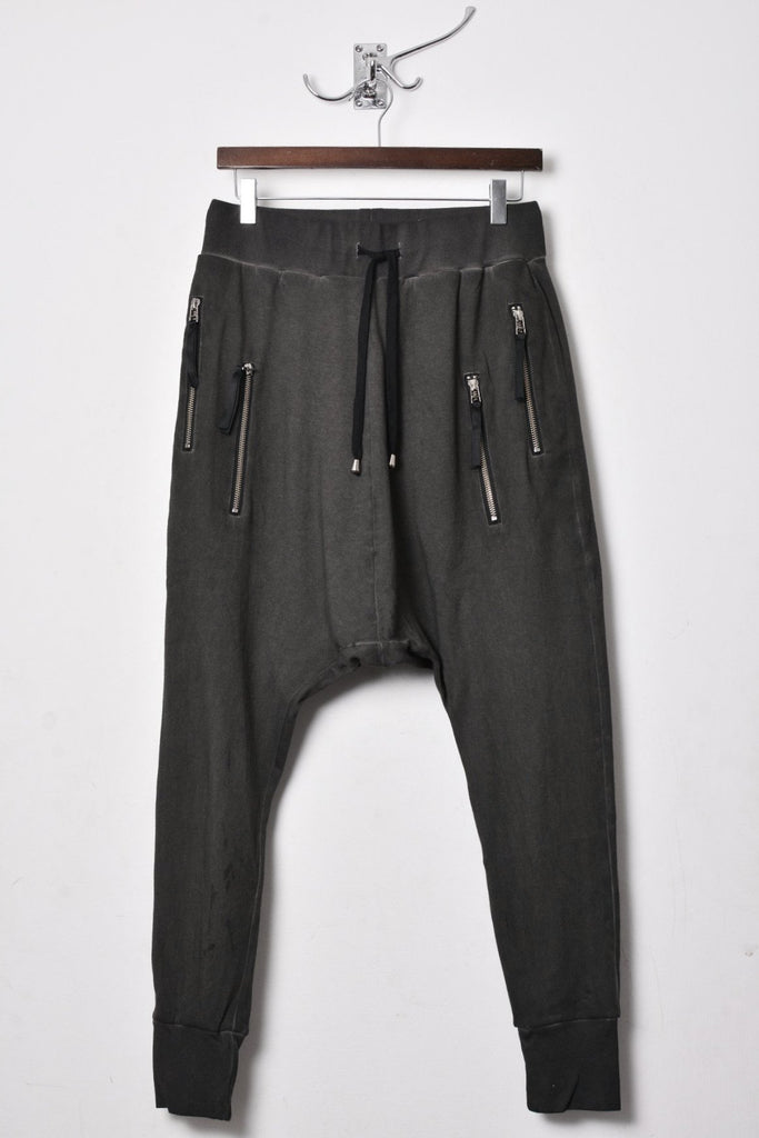 UNCONDITIONAL SS18 Military CD drop crotch full length trousers with SINGLE zip pockets.