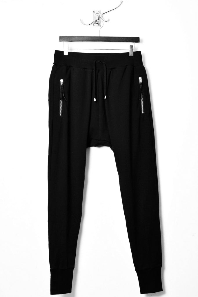 UNCONDITIONAL Black full length higher crotch heavy jersey joggers with back zips.